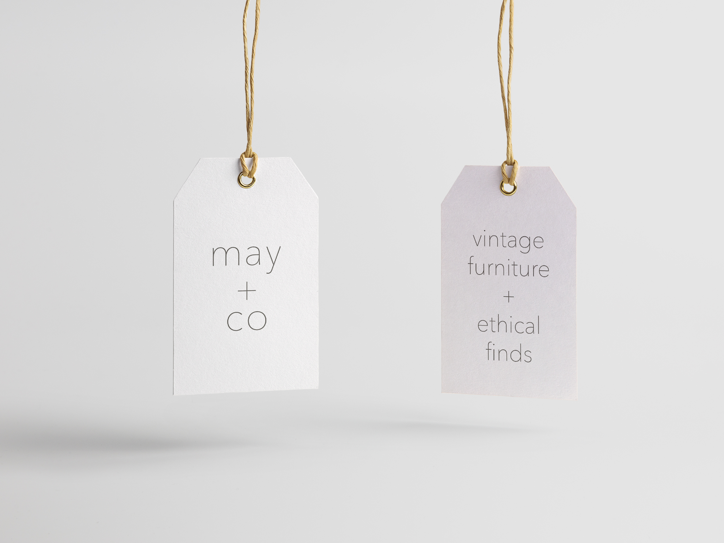 2 name tags for May + Co