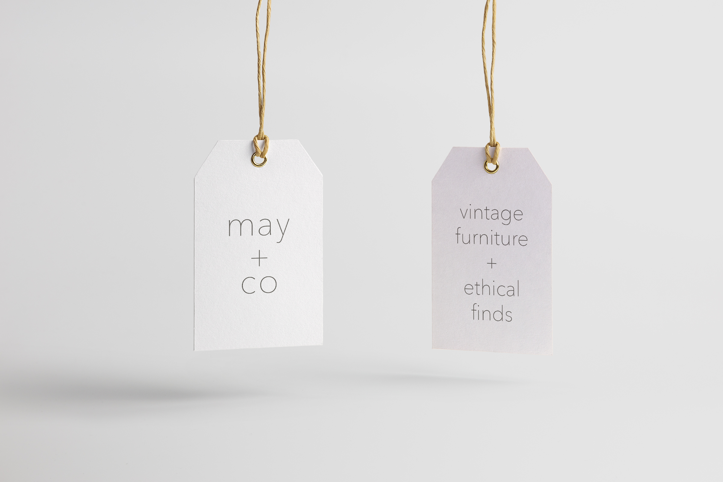 Image showing tags with May + Co logo on