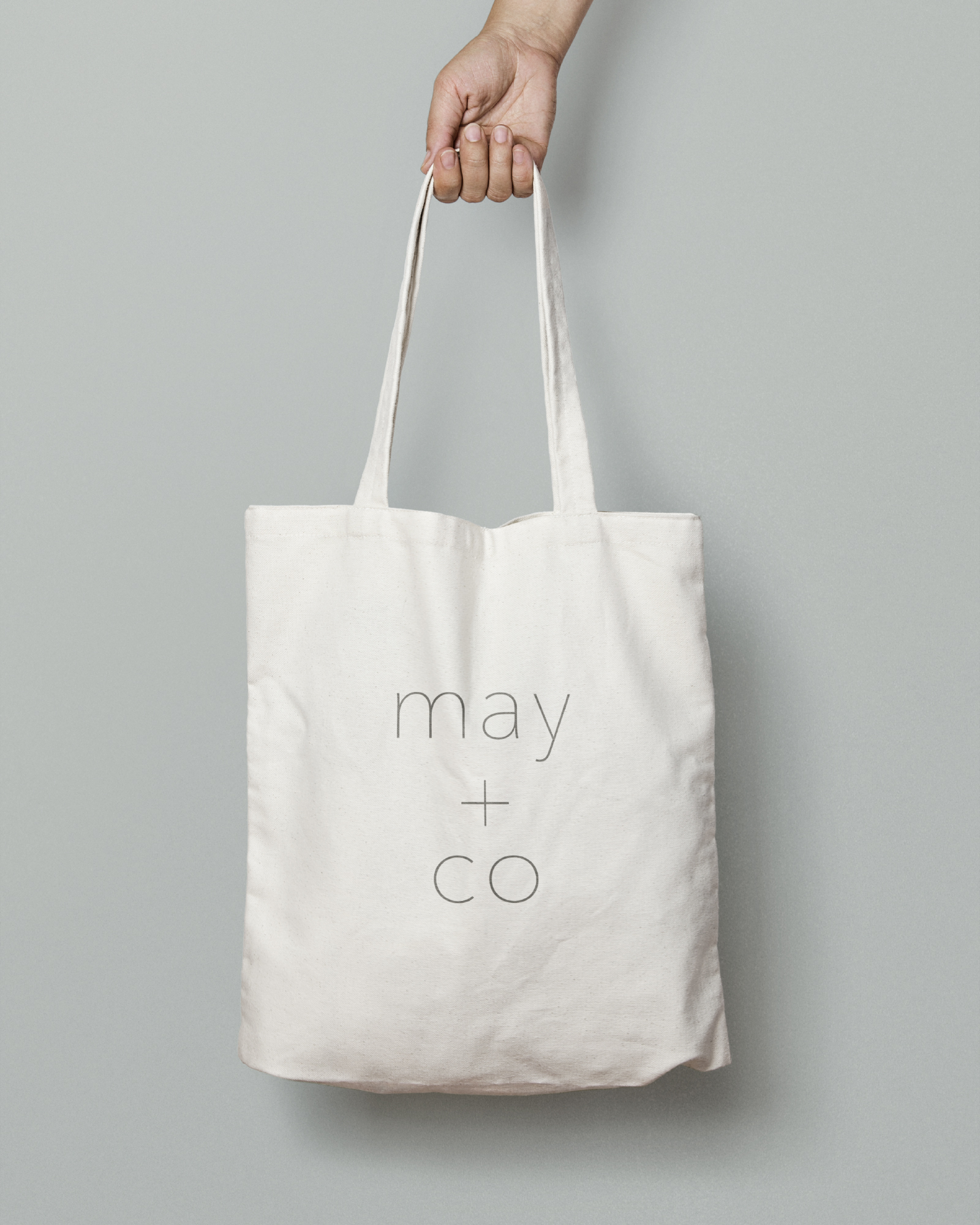 The May + Co logo on a tote bag