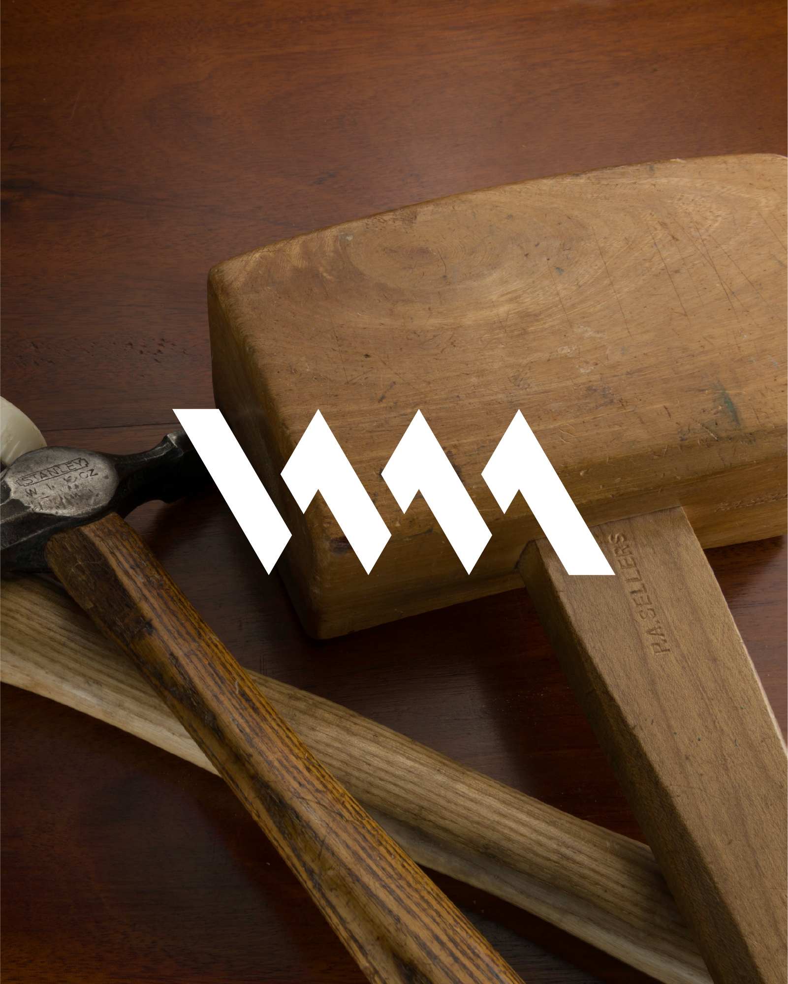 Woodworking Masterclasses logo laid across image of woodworking tools
